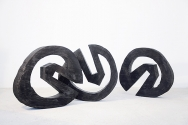 """wheel I – III"", 2009 <br /> Khaja wood burnt black, diameter each approx. 94 cm <br /> owned by the artist"